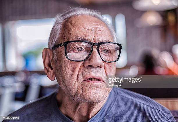 Elderly Dementia Man Asking Question While Waiting For Breakfast