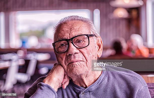 Elderly Dementia Man Day Dreaming Waiting For Breakfast