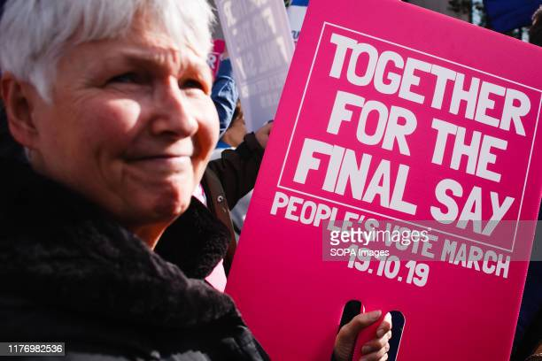 Elderly demonstrator with a placard at Park Lane during the protest A mass 'Together for the Final Say' march organised by the 'People's Vote'...