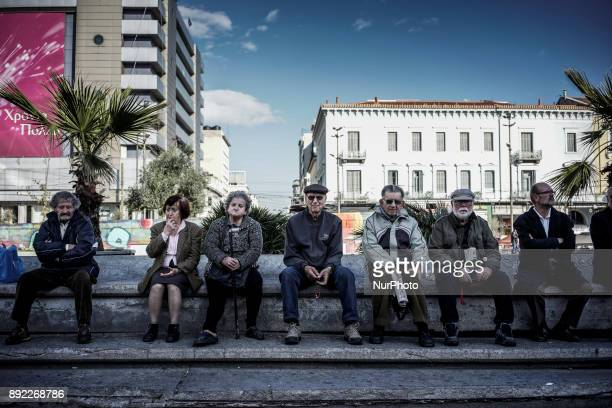 Elderly demonstrators members of the Greek Communist Party sit in Omonia squeare before the demonstration during the 24 hour strike Athens December...