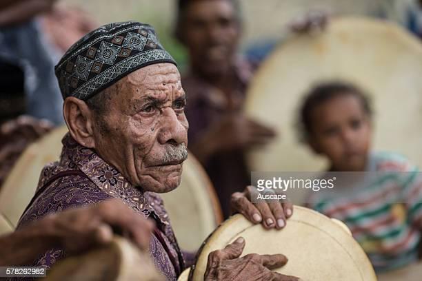 Elderly drummer member of a band of musicians performing a welcome dance Kokas Fakfak regency Papua Province Indonesia