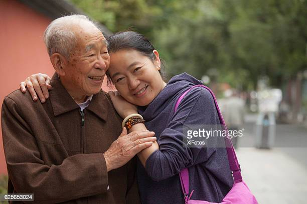 elderly father and his middle aged daughter - chinese culture stock pictures, royalty-free photos & images