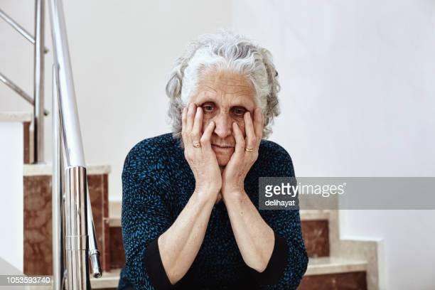elderly feeling sad - struggle stock pictures, royalty-free photos & images
