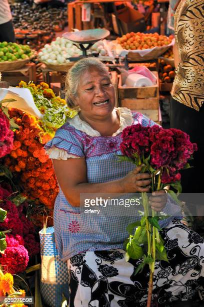 elderly flowerseller in the market at teotitlán - oaxaca stock photos and pictures