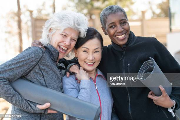elderly friends posing after yoga - active seniors stock pictures, royalty-free photos & images