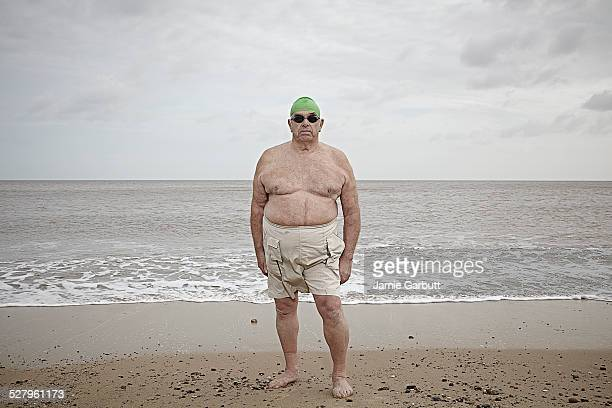 elderly gentleman ready to swim in the cold sea - shirtless stock pictures, royalty-free photos & images
