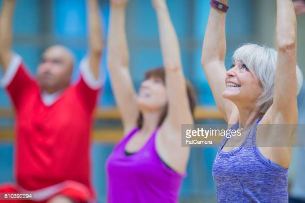 Elderly Group of People Exercising Together