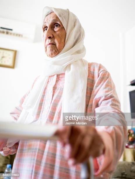 Elderly hands on walker