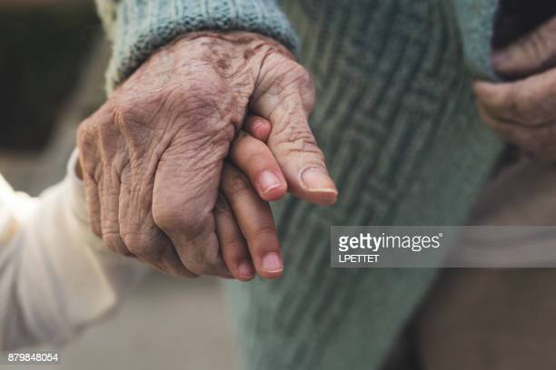 elderly hands - hospice stock pictures, royalty-free photos & images