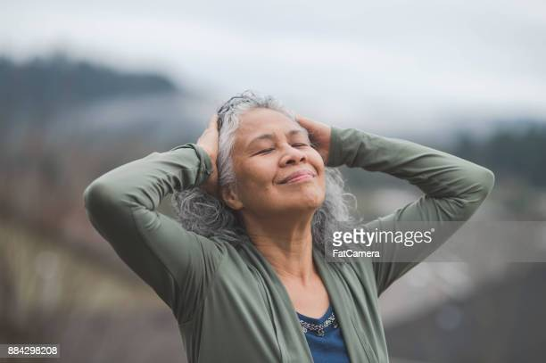 elderly hawaii woman practicing yoga - mindfulness stock pictures, royalty-free photos & images