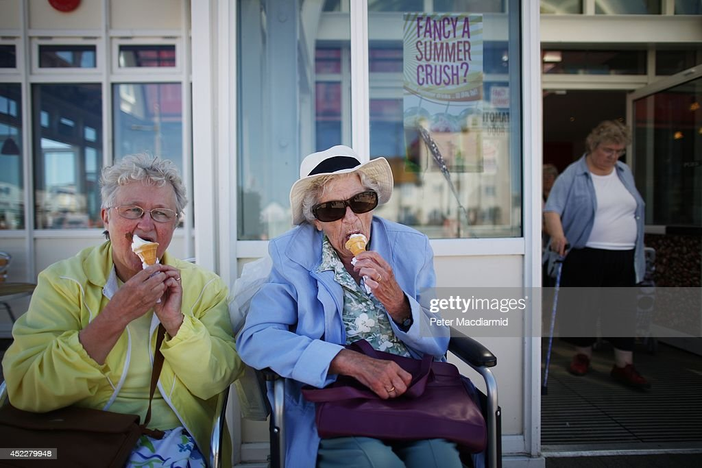 Elderly holidaymakers enjoy a traditional ice cream cone on the South Beach on July 17, 2014 in Lowestoft, England. The Met Office has issued a heatwave alert as temperatures throughout England and Wales are predicted to reach their highest level of the year this weekend.