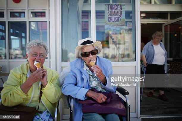Elderly holidaymakers enjoy a traditional ice cream cone on the South Beach on July 17 2014 in Lowestoft England The Met Office has issued a heatwave...