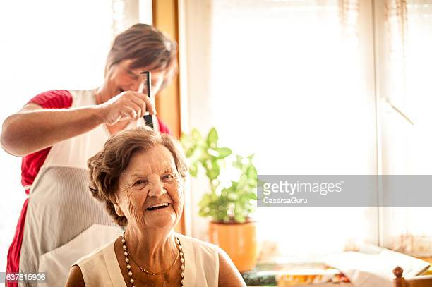 elderly home care service by a caregiver - body care stock pictures, royalty-free photos & images