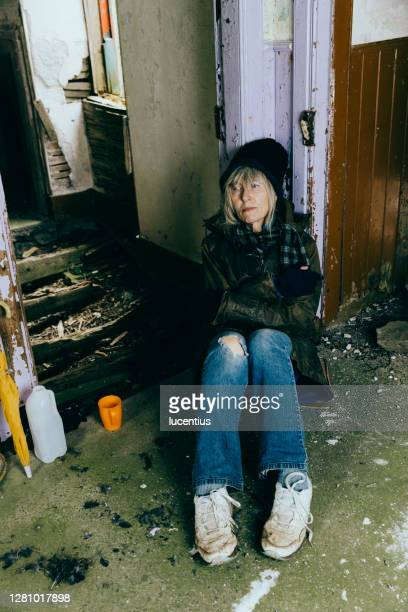 elderly homeless senior woman in an abandoned ruin - condition stock pictures, royalty-free photos & images