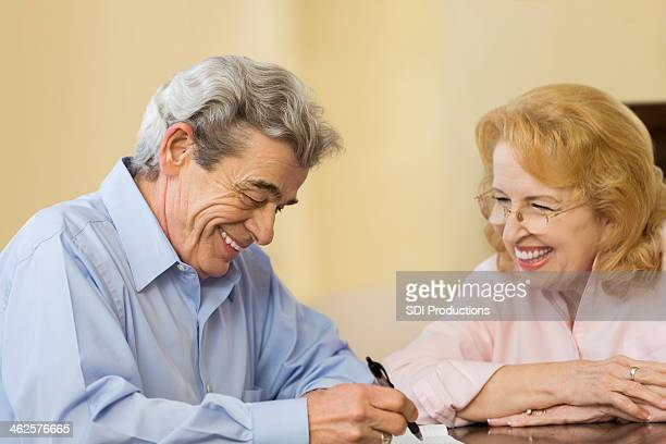 Elderly husband and wife updating will together