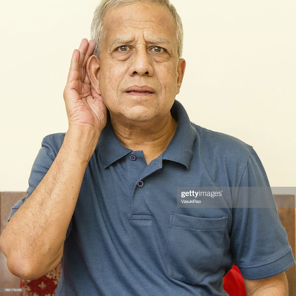 Elderly Indian man has hearing difficulty : Stock Photo