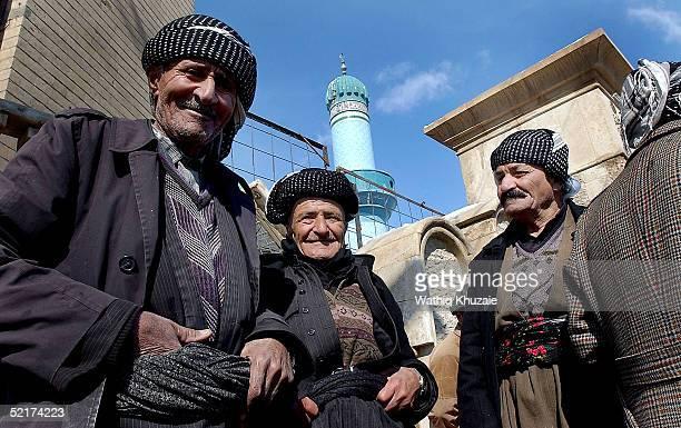 Elderly Iraqi Kurdish men smile on February 10, 2005 in Suleimaniya, Iraq. With just over half the estimated vote announced so far, a coalition of...