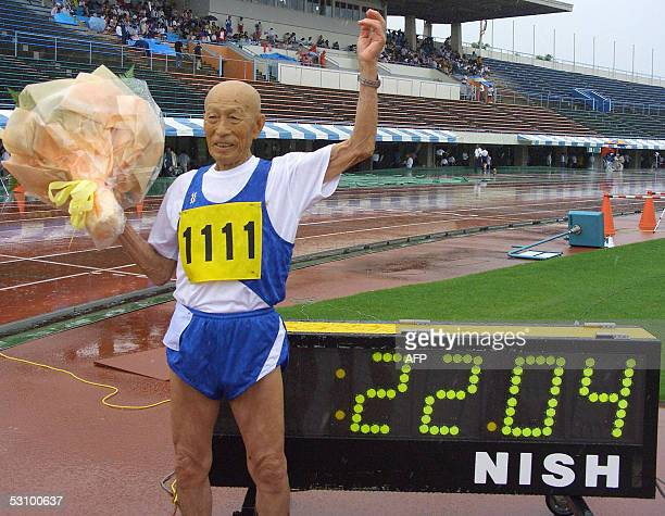 Elderly Japanese runner Kozo Haraguchi celebrates after setting the new world record of the 100m dash 9599 yearold class in 2204 seconds during the...