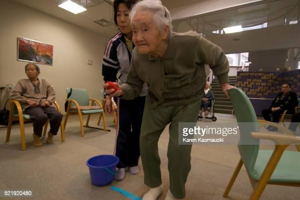 Elderly Japanese Woman Exercising
