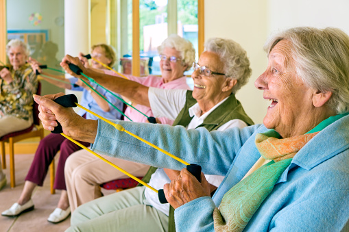 Elderly ladies exercising in a gym. 509731806