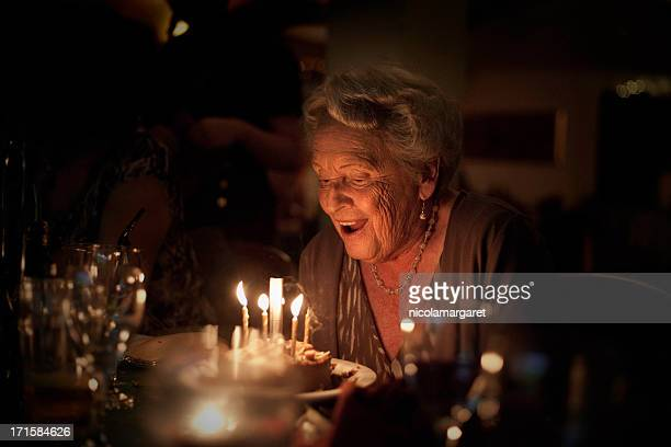 elderly lady:  birthday celebration - birthday cake stock pictures, royalty-free photos & images