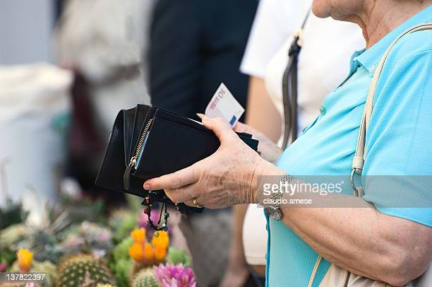 Elderly Lady is Paying the Florist. Color Image