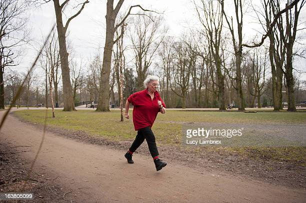Elderly lady jogging in the park