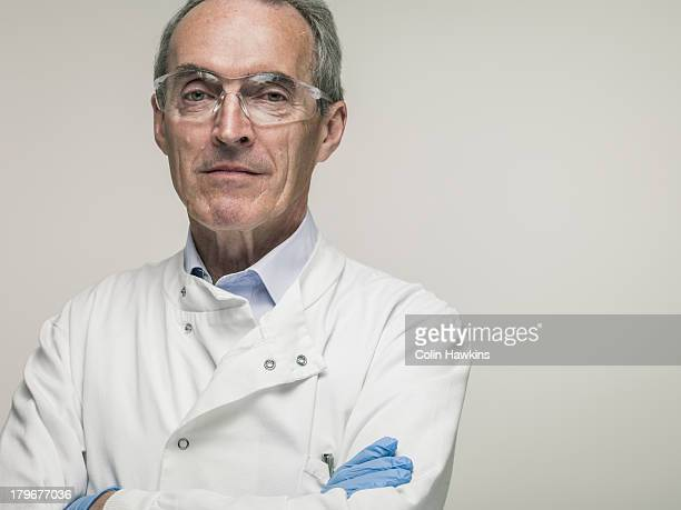 elderly male health worker - scientist stock pictures, royalty-free photos & images