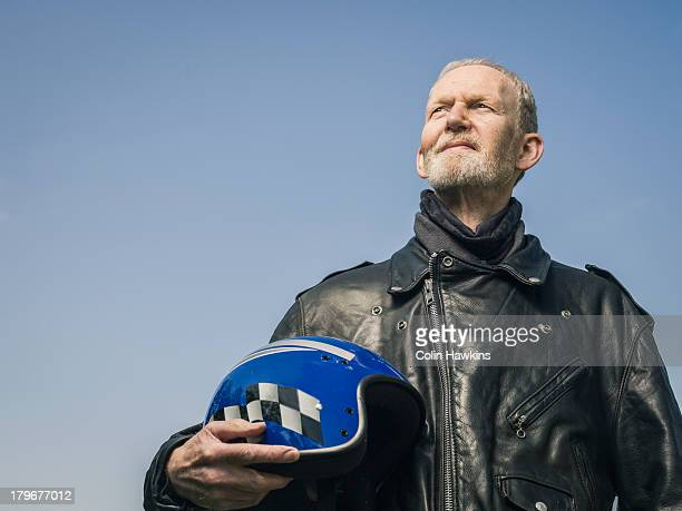 elderly male motor cyclist - crash helmet stock pictures, royalty-free photos & images