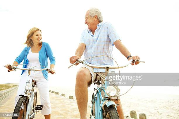 Elderly man and woman on bicycles