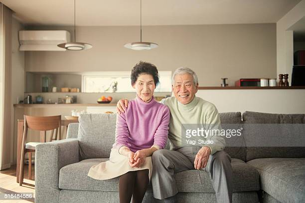 Elderly Man and Woman Sitting on Couch