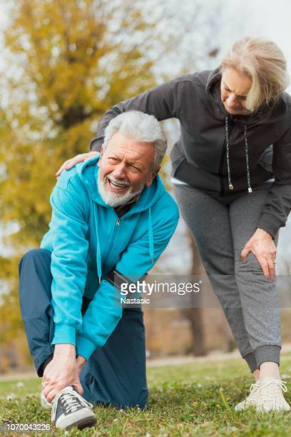 elderly man ankle sprain pain while running - sprain stock pictures, royalty-free photos & images