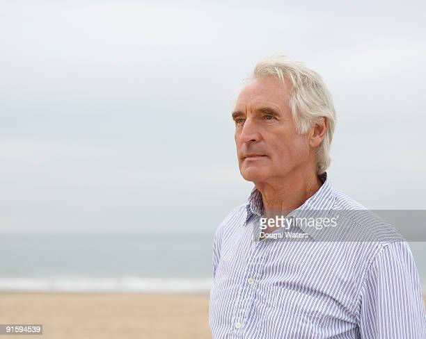 elderly man at beach. - one man only stock pictures, royalty-free photos & images