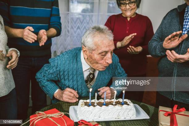 elderly man celebrates birthday with family - 90 plus years stock pictures, royalty-free photos & images