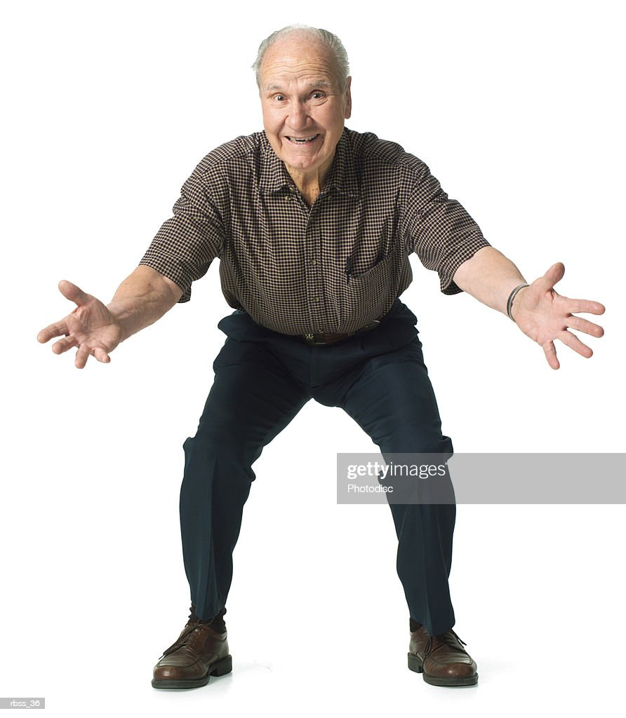 Elderly man crouches down with his arms wide open. : Foto de stock