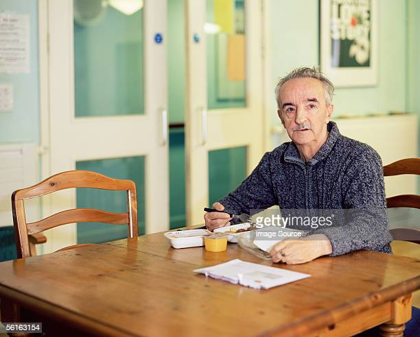 Elderly man eating breakfast