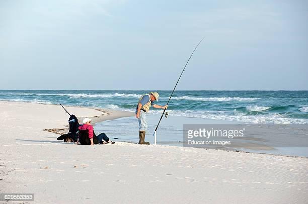 Elderly man fishing Gulf Coast Florida USA