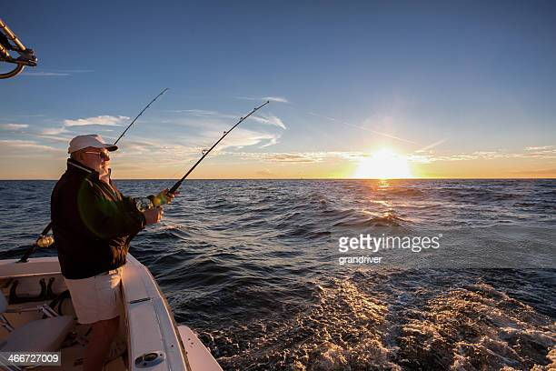 elderly man fishing - fishing industry stock pictures, royalty-free photos & images