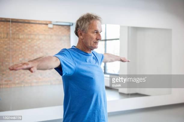 elderly man having rehabilitation at health club, stock photo - drug rehab stock pictures, royalty-free photos & images