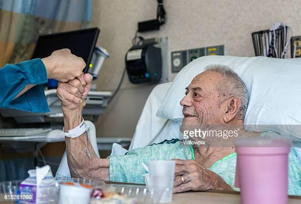 Elderly Man Hospital Patient Fist Bump Greeting Family Member