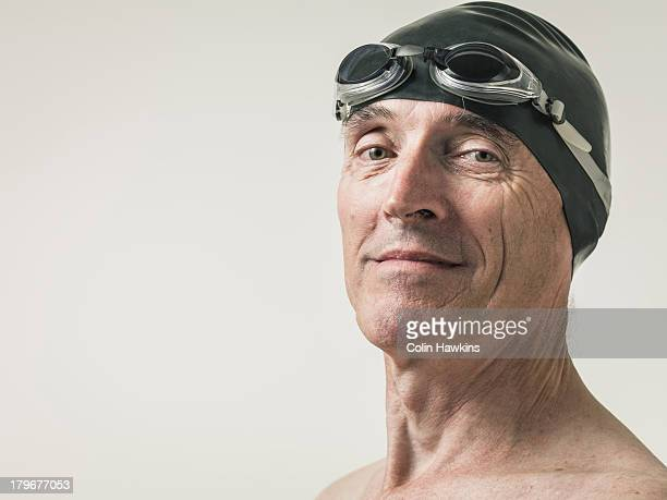 Elderly man in swimming goggles and hat