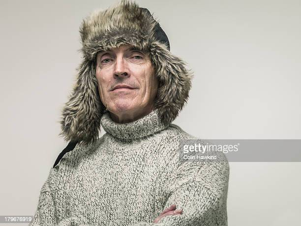 elderly man in warm winter clothing - fur hat stock photos and pictures