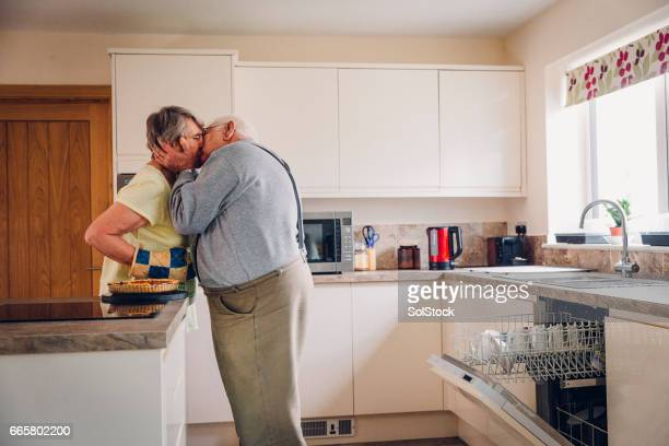 Elderly Man Kisses his Wife