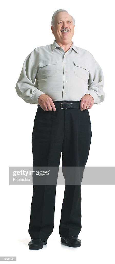 Elderly man laughs while holding his belt. : Foto de stock