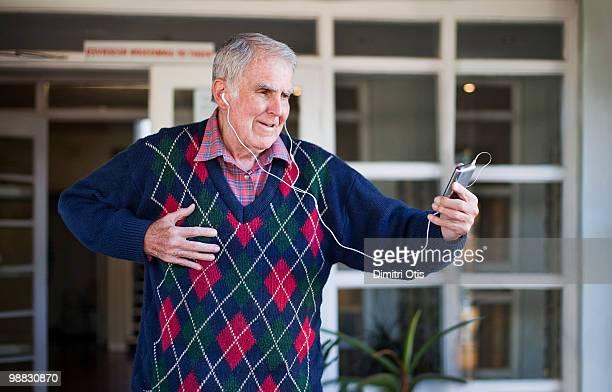 Elderly man listening to music with headphones