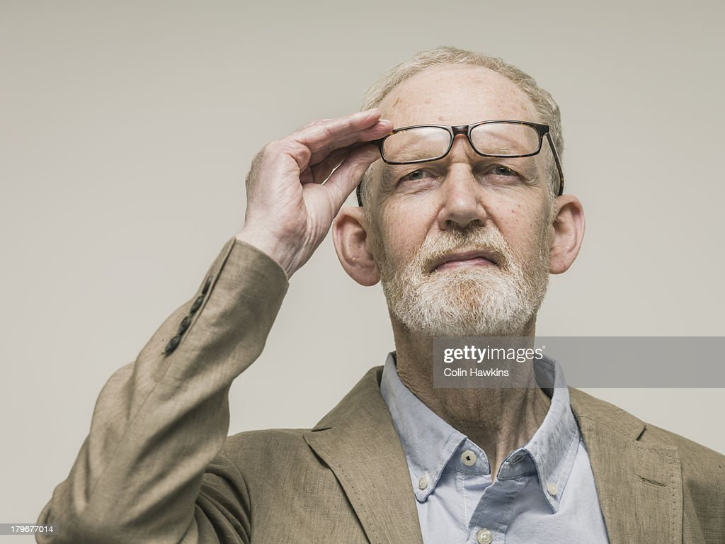 Elderly man looking with glasses : Stock Photo