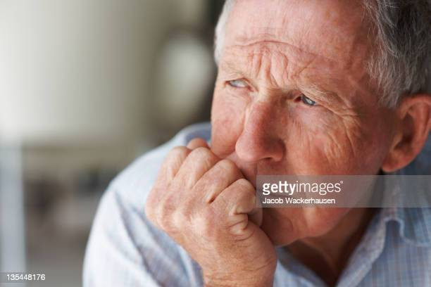 elderly man lost in thought - only senior men stock pictures, royalty-free photos & images