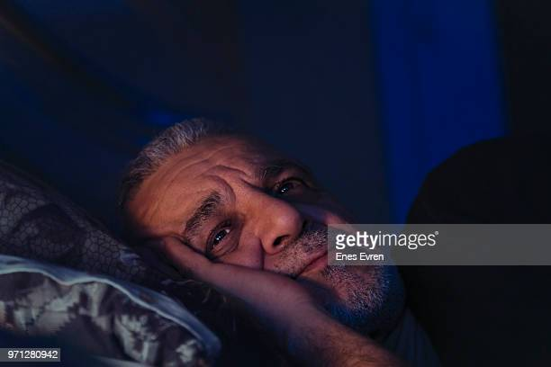 Elderly man lost in thought