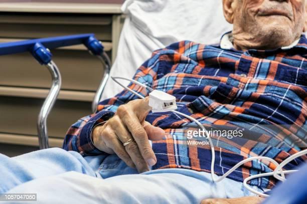 Elderly Man Medical Patient Finger Pulse Trace Oxymeter
