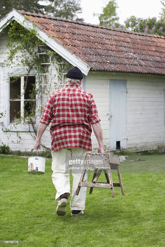 Elderly Man Painting His Summer Cottage Sweden Stock Photo